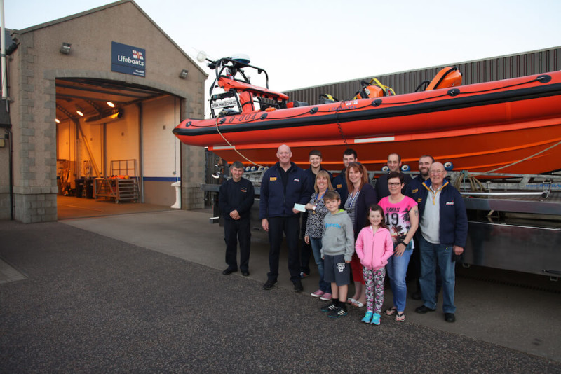 Nichola Rhind of Turriff Ladies Circle presenting Chassey Findlay from RNLI Macduff with a cheque in front of Macduff lifeboat station