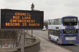 digital road sign showing a warning of the bus lane enforcement start date