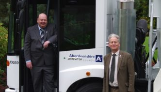 Peter Argyle on right and Alan S. Buchan, with one of the new vehicles.