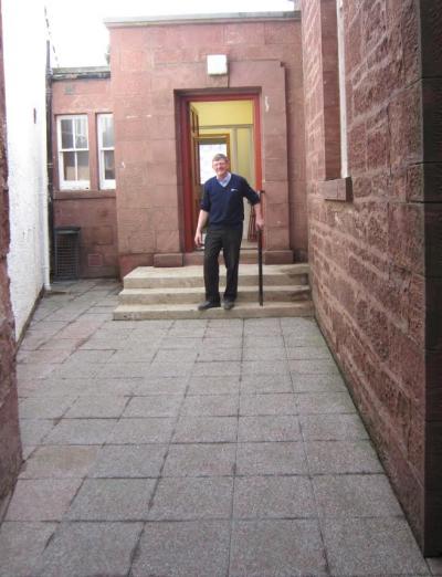 Ben Ewen admiring his handy work around the side entrance.