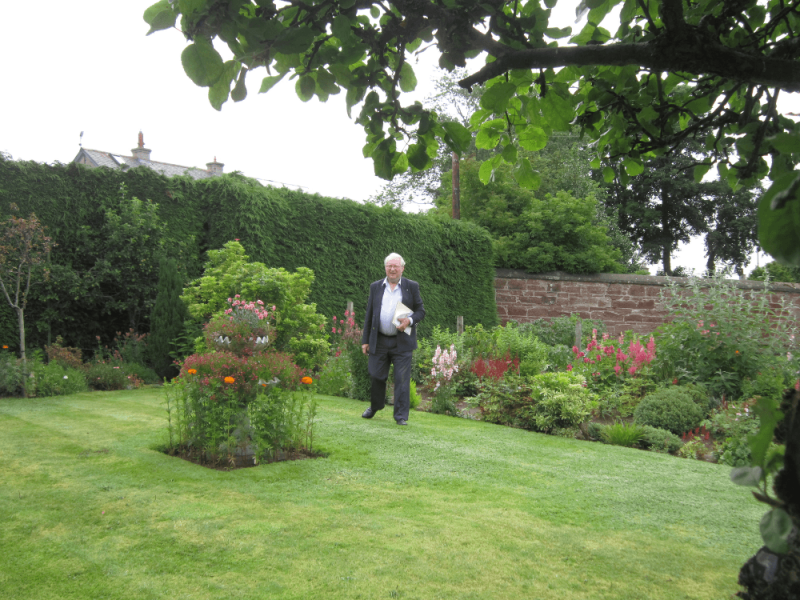 Charlie Laing judging one of the Turriff Gardens 2014 entries