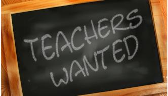 Teachers wanted written on a blackboard