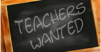 Teachers wanted written on a blackboard