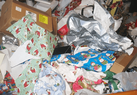piles of used Christmas wrapping paper