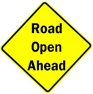 Yellow road open ahead sign