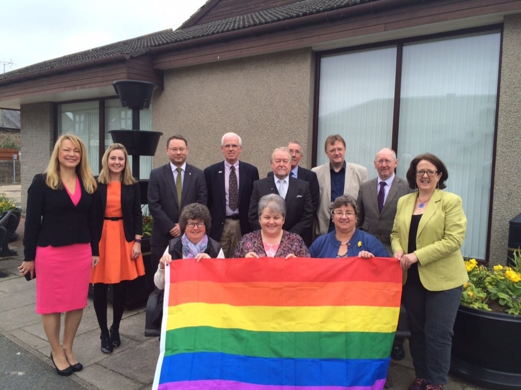 Councillors and Officers with the rainbow flag before the Formartine Area Committee meeting