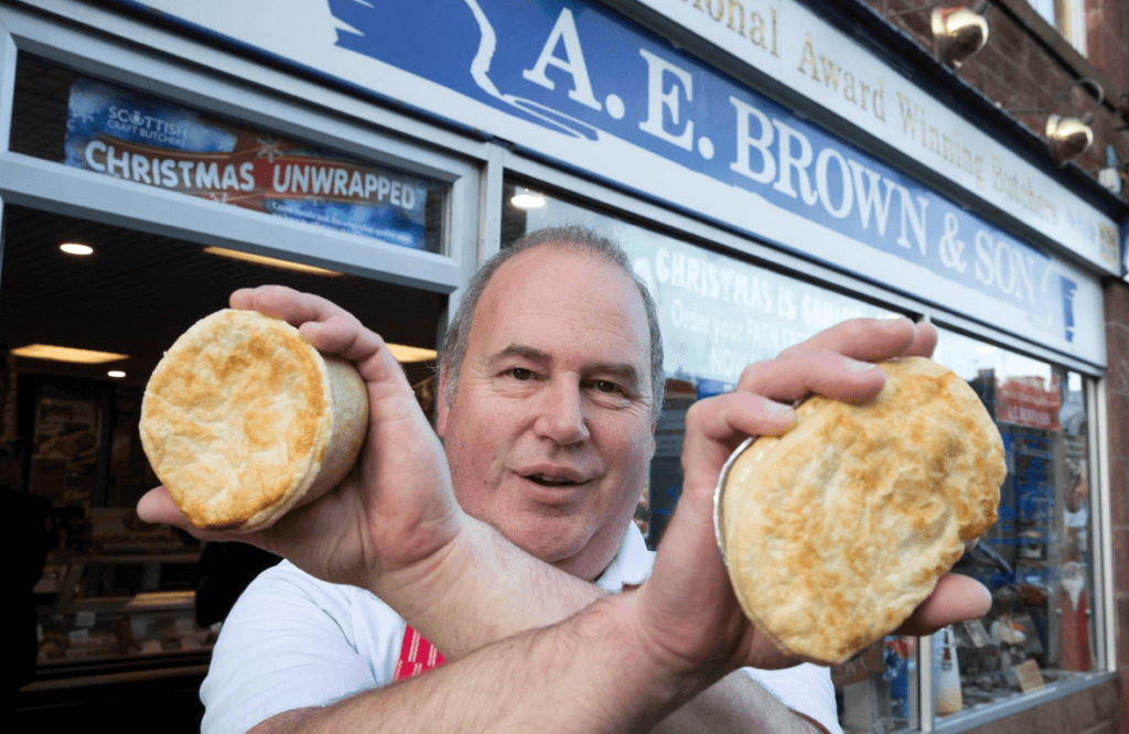 John Brown outside his Main Street shop in Turriff with two of his pies which were named in the 2017 Craft Butchers Honours List