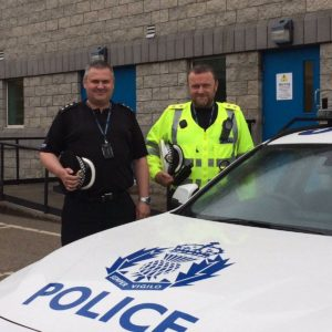 Chief Inspector Stewart Mackie and Inspector Jon Barron at Inverurie Police Station next to a police car