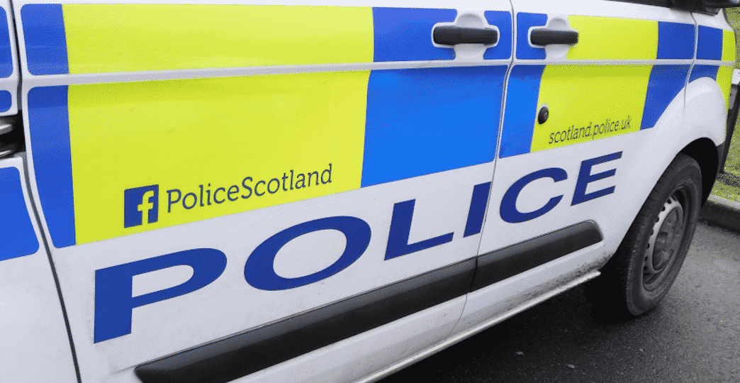 Police Scotland van side on with hi visibility markings and the words Police Scotland and Police