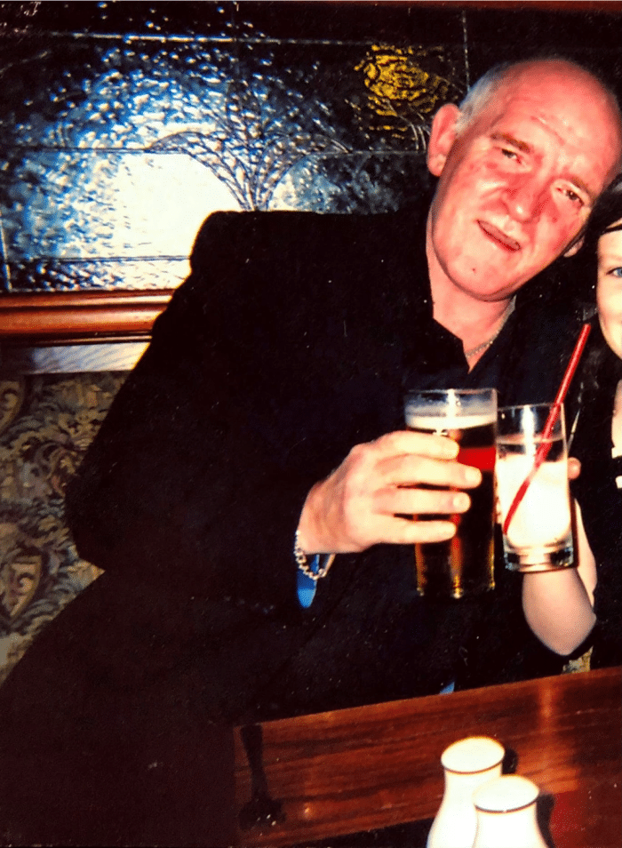 Picture of Robert Parks in a black jacket holding a pint of beer