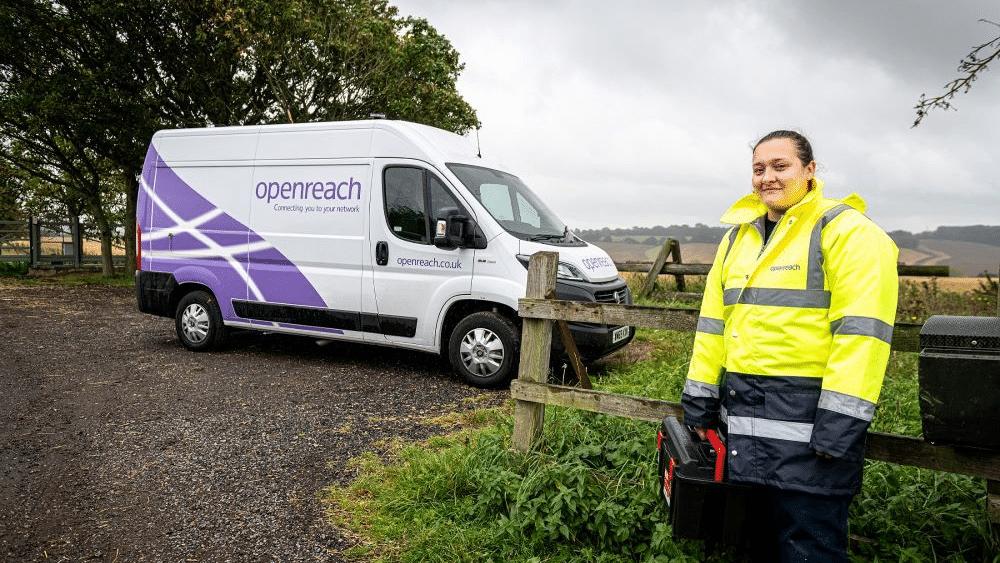 BT Openreach van with female engineer standing in rural location